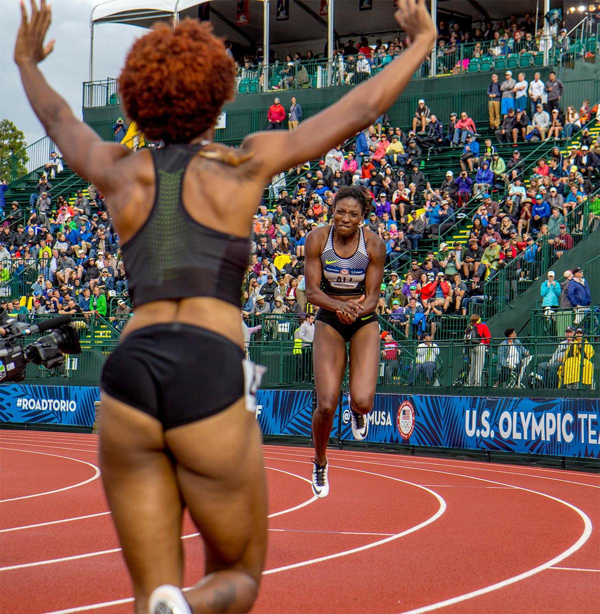 Nike's Brianna Rollins (left) and Nia Ali (right) celebrate their first and third place in the 100 meter hurdles. Rollins won with a time of 12.34 and Ali finished third with a time of 12.55. Photo by August Frank, Oregon News Lab