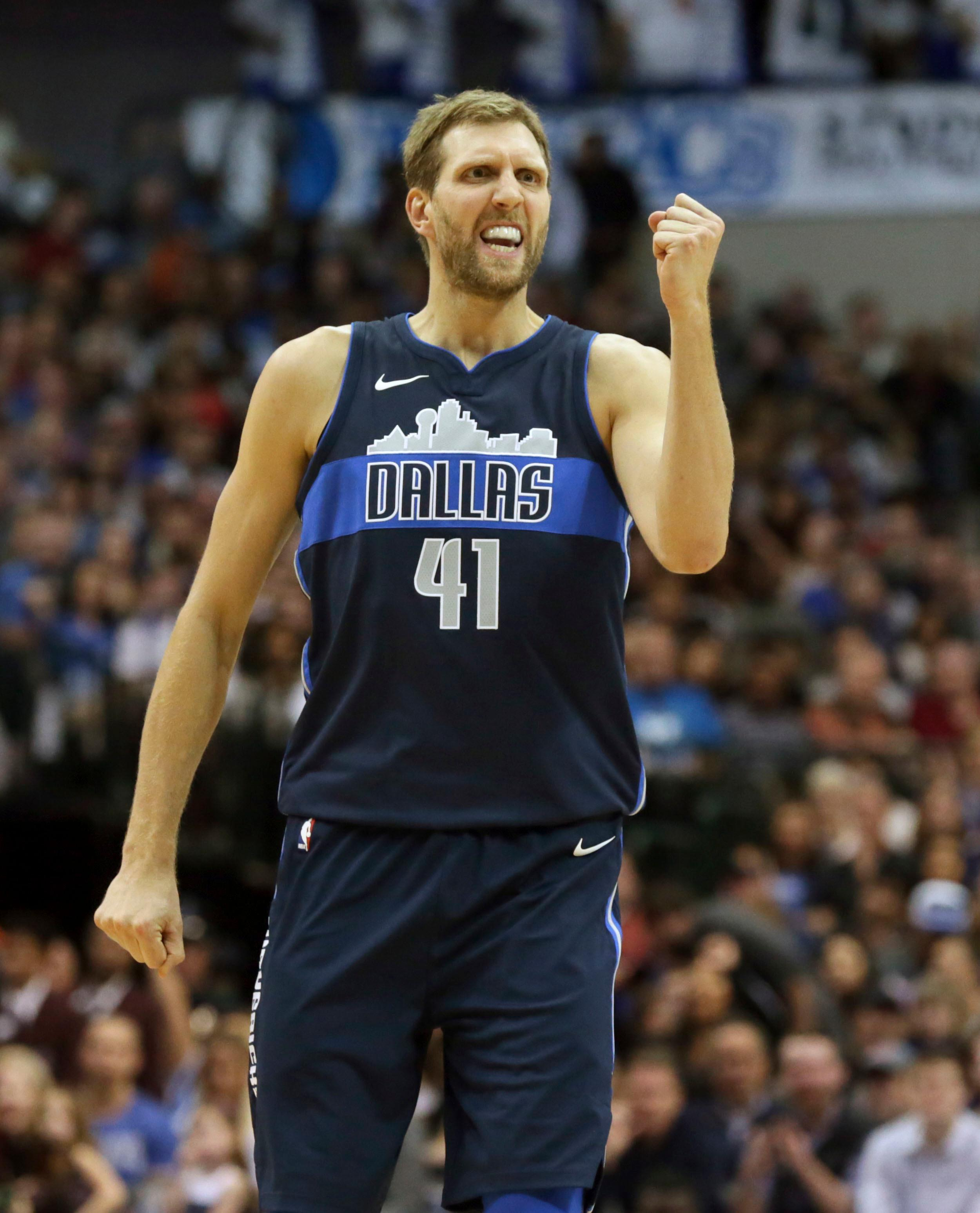 Dallas Mavericks forward Dirk Nowitzki (41), of Germany, reacts to a play during the second half of an NBA basketball game against the Oklahoma City Thunder in Dallas, Saturday, Nov. 25, 2017. (AP Photo/LM Otero)