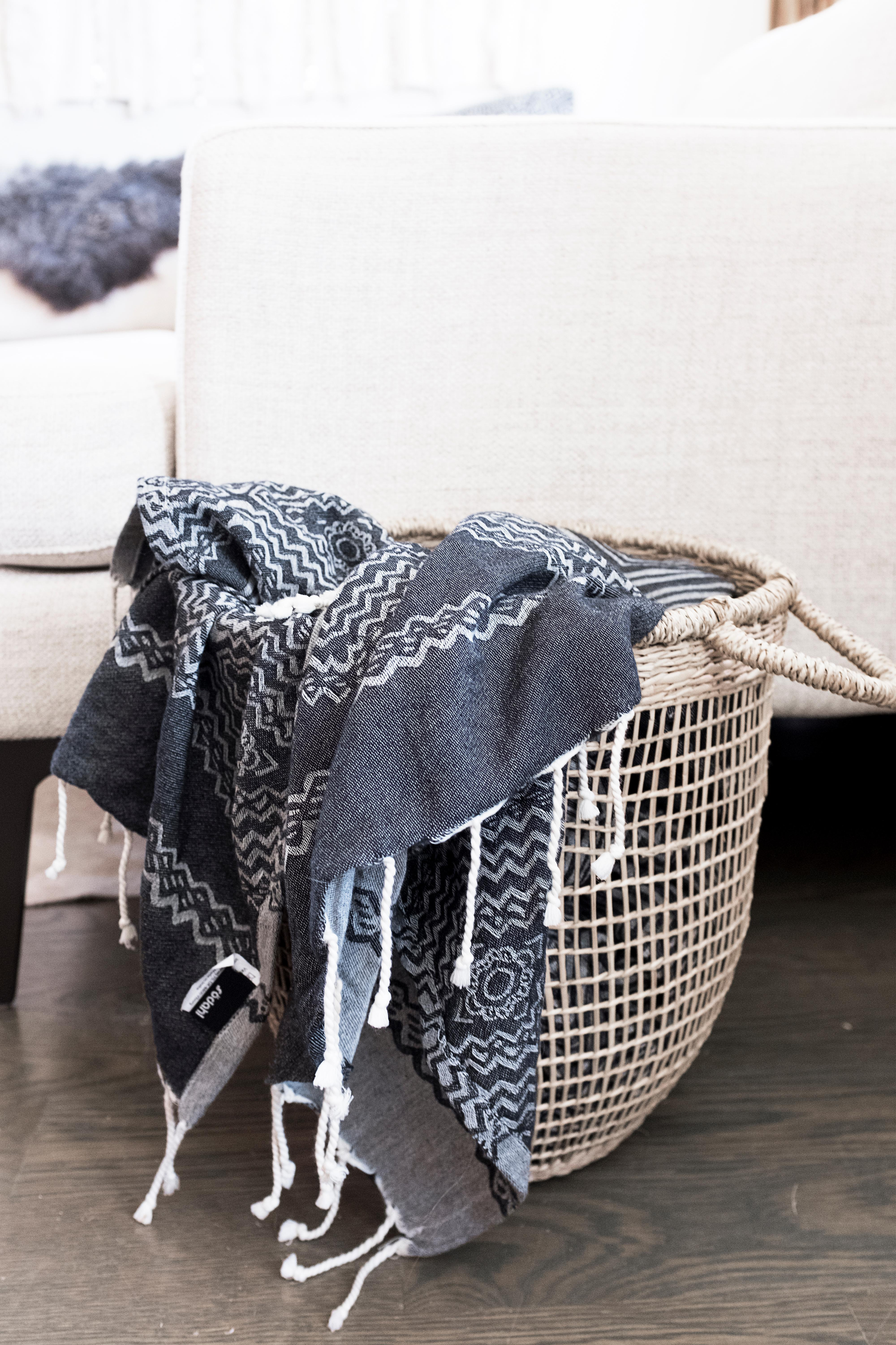 Finally, use a basket at the end of the couch to hold a lighter throw blanket for those warmer spring nights. (Image: Ashley Hafstead)