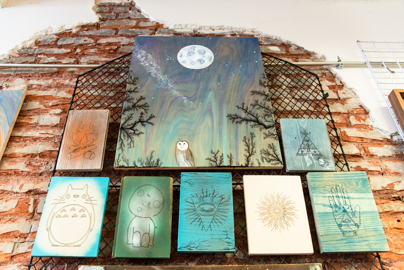 Matt Meyung from Newport utilizes his carpentry skills in his art, working with reclaimed wood, paint, and a style of electric wood burning called Lichtenburg to craft his pieces. He's inspired by the colors and landscapes of the Southwestern U.S. Matt's Newport gallery and workshop called Artifact is where the group of friends often gather to work on projects, host gallery events, and just hangout. / Image: Melissa Sliney // Published: 6.26.19