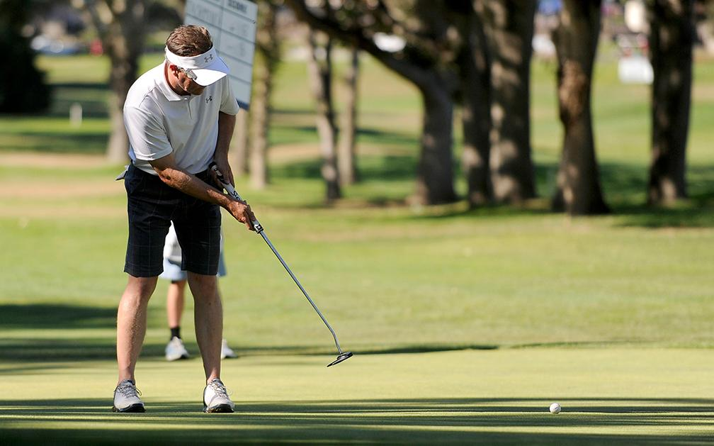 Andy Atkinson / Mail TribuneJohn Ellsworth watches his ball roll across the 10th green during the Jr Senior Men's Championships at the Rogue Valley Country Club Monday afternoon.