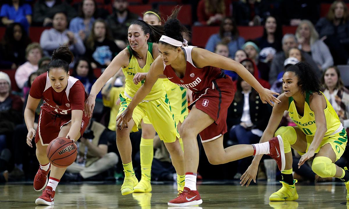 Stanford's Marta Sniezek, left, and Kaylee Johnson chase a loose ball with Oregon's Maite Cazorla, second left, and Satou Sabally during the first half of an NCAA college basketball game in the finals of the Pac-12 Conference women's tournament, Sunday, March 4, 2018, in Seattle. (AP Photo/Elaine Thompson)