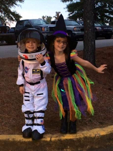 NASA astronaut hangs with a friendly witch on Halloween.