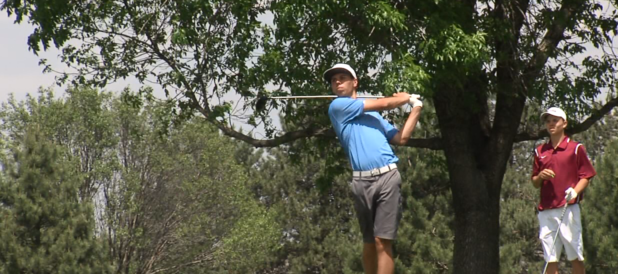 St. Cecilia's Jack Thompson stares down his drive from the tee box. (NTV News)