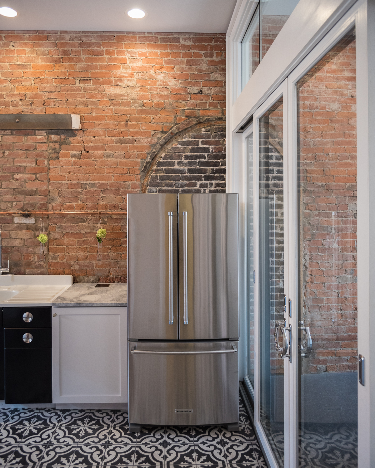 Complete with nine townhomes, Boone Block is Covington's newest living space. It's filled with exposed brick, tall ceilings, and plenty of old & new features. Basically, it's your dream home. / ADDRESS: 406-422 Scott Blvd Covington, KY 41011. // Image: Phil Armstrong, Cincinnati Refined
