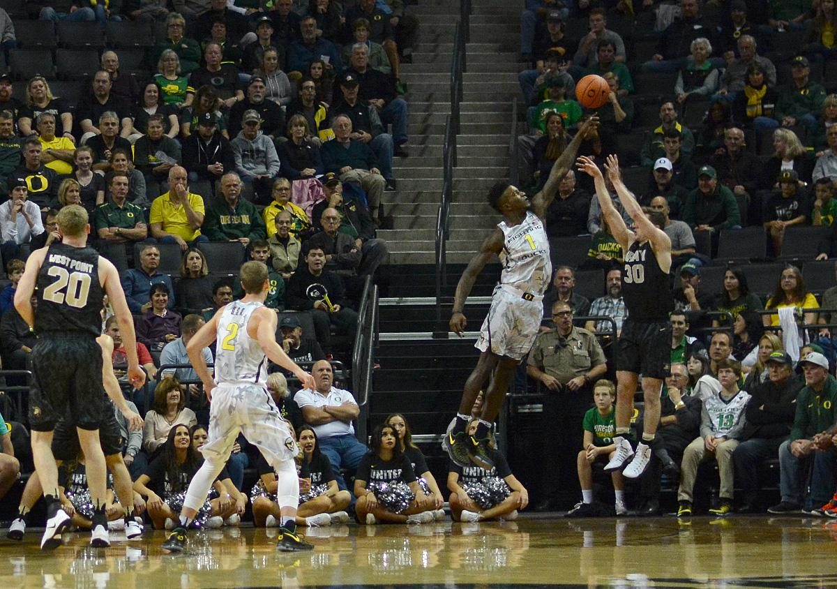 Ducks' Jordan Bell (#1) blocks Army's Jordan Fox (#30) attempted shot. In front of a sold out crowd, Oregon defeated Army 91-77 on opening night. Photo by Jacob Smith, Oregon News Lab