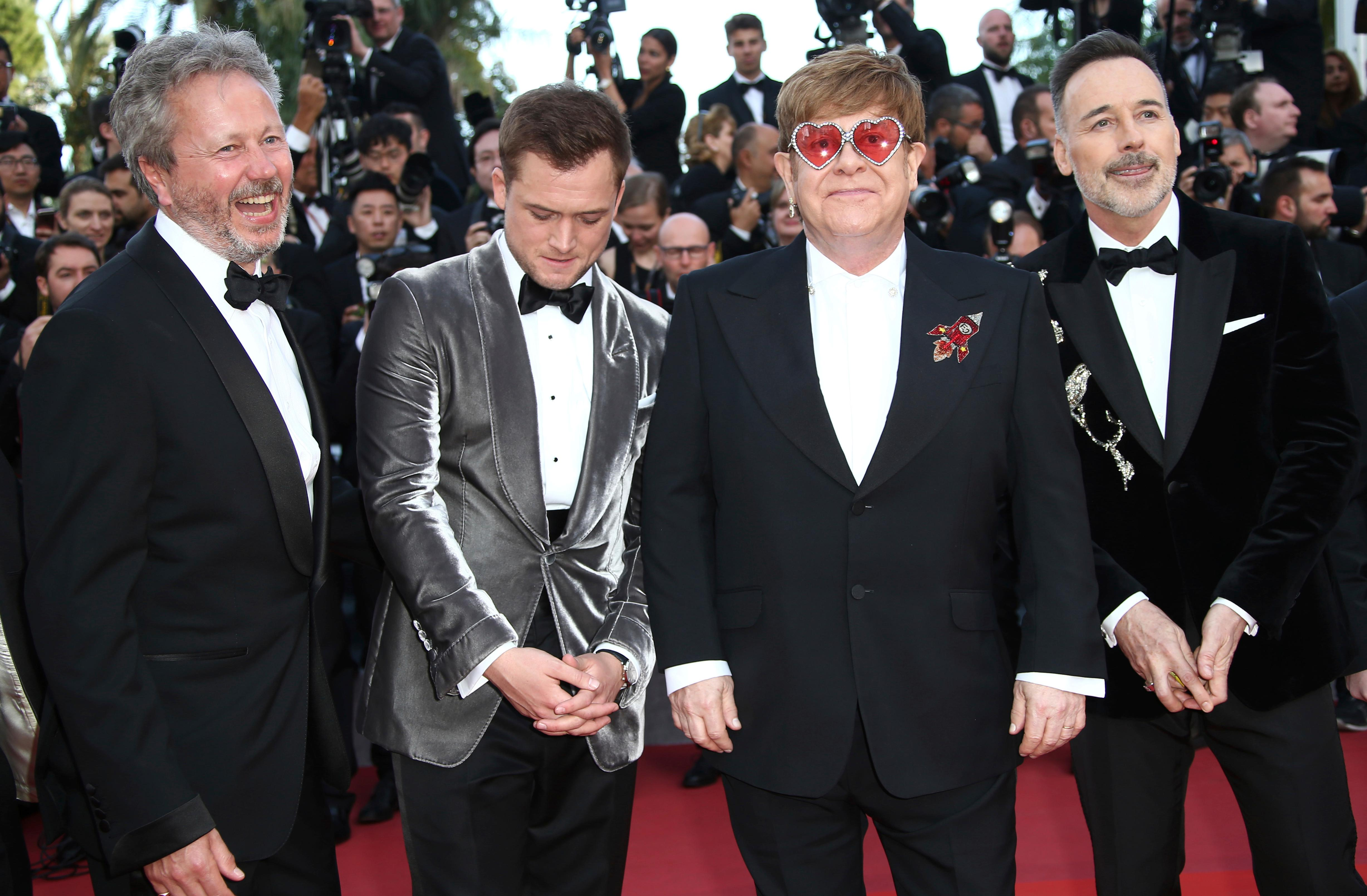 Producer Adam Bohling, actor Taron Egerton, singer Elton John and producer David Furnish pose for photographers upon arrival at the premiere of the film 'Rocketman' at the 72nd international film festival, Cannes, southern France, Thursday, May 16, 2019. (Photo by Joel C Ryan/Invision/AP)
