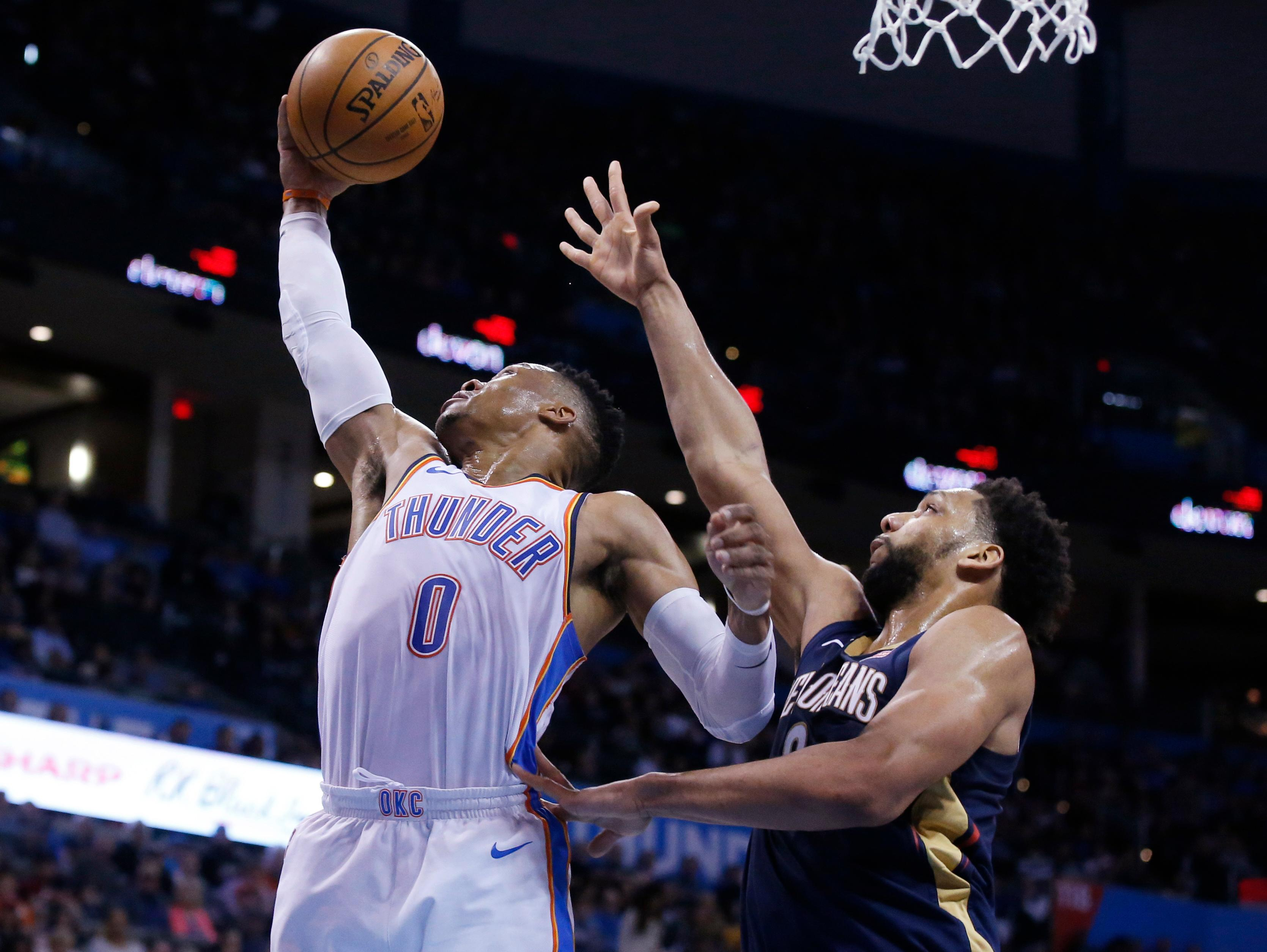 Oklahoma City Thunder guard Russell Westbrook (0) grabs a rebound in front of New Orleans Pelicans center Jahlil Okafor, right, during the first half of an NBA basketball game in Oklahoma City, Thursday, Jan. 24, 2019. (AP Photo/Sue Ogrocki)