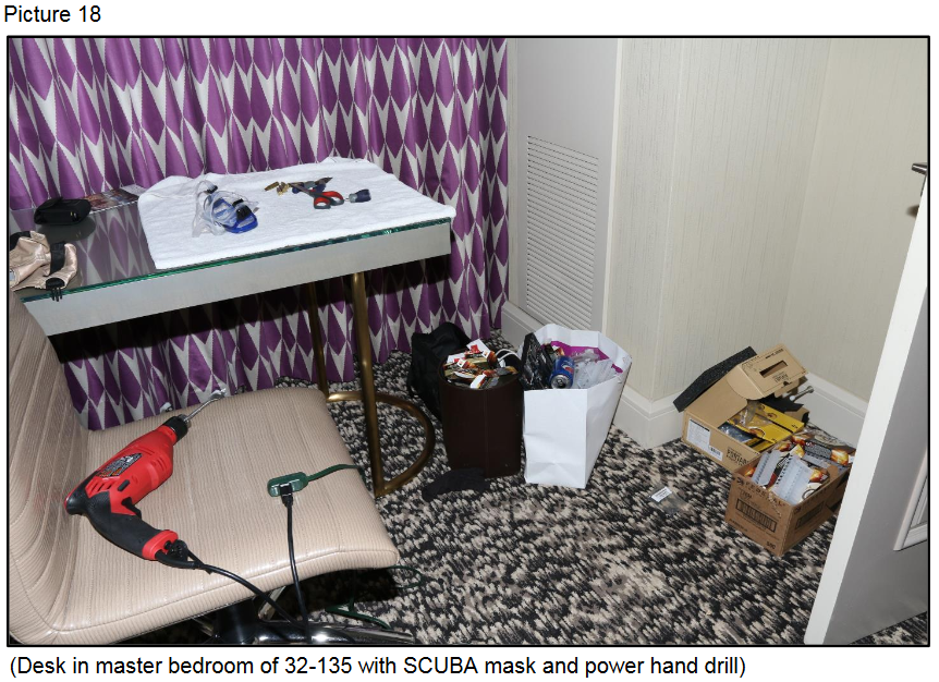 Desk in master bedroom of 32-135 with SCUBA mask and power hand drill{ }(Courtesy LVMPD)