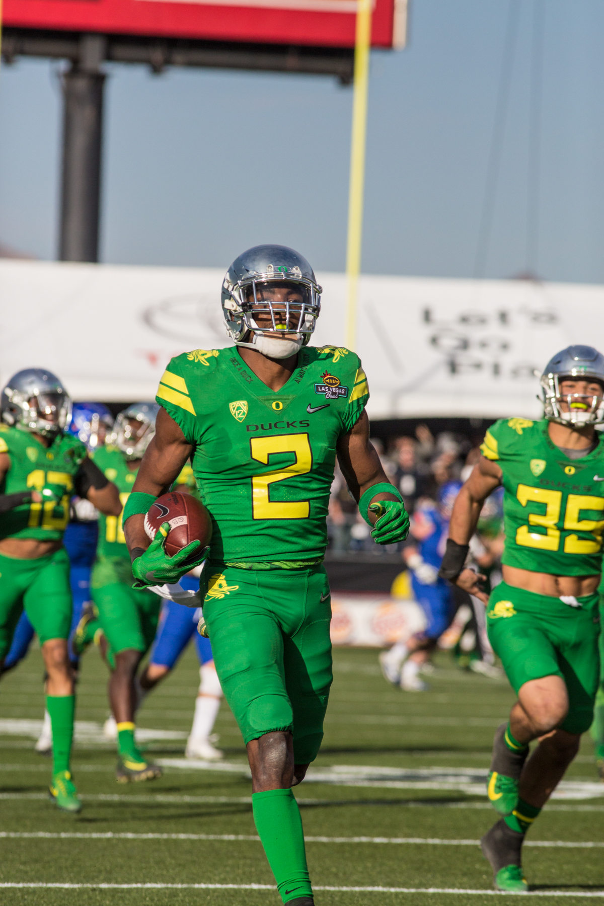 Oregon safety Tyree Robinson (#2) runs the ball for a touchdownfollowing a Boise State fumble. The Oregon Ducks trail the Boise State Broncos 14 to 24 at the end of the first half of the Las Vegas Bowl at Sam Boyd Stadium in Las Vegas, Nevada. Photo by Ben Lonergan, Oregon News Lab