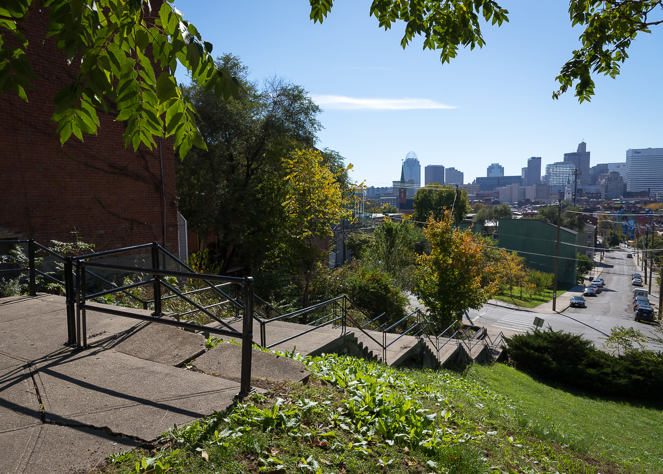 These public stairs, known as the Main Street Steps, follow the path of the former incline. While walking up the stairs today, it's immediately apparent that the view of the city below would've been a sight to behold from the incline platform. / Image: Phil Armstrong, Cincinnati Refined // Published: 1.2.19
