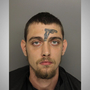 Man with a tattoo of a gun on his face now charged with illegally possessing a gun