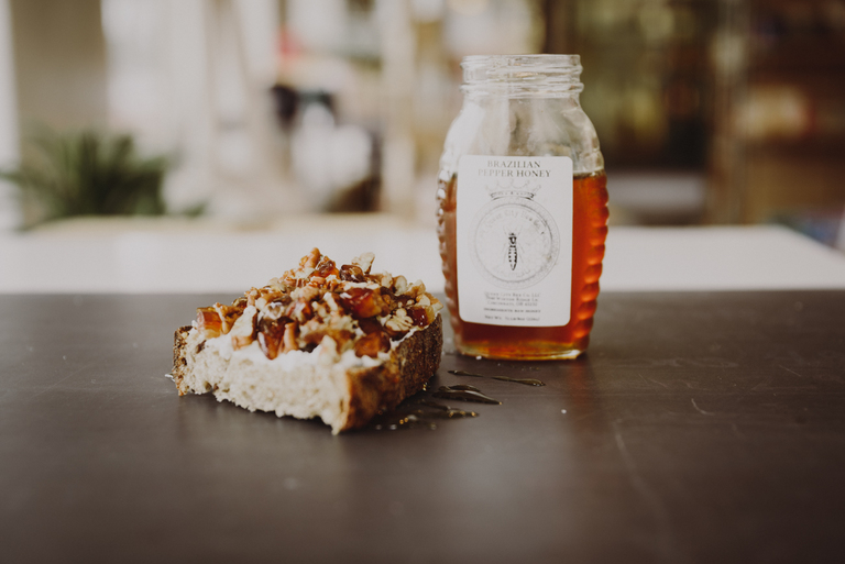 Organic ricotta cheese topped with dates and pecans and local Queen City Bee Co. pepper honey / Image: Brianna Long // Published 7.30.18