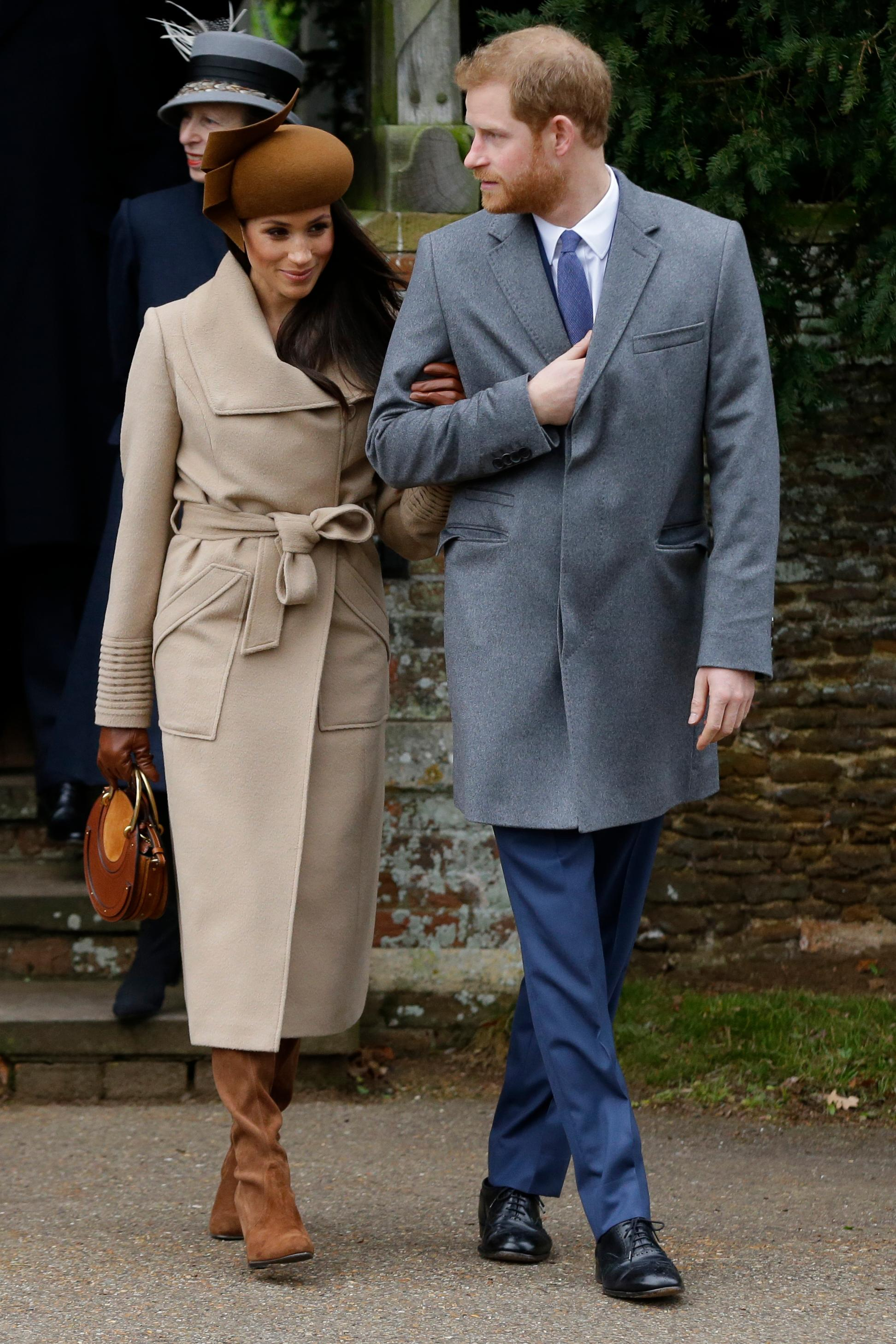 Prince Harry and his fiancee Meghan Markle arrive to attend the traditional Christmas Day service, at St. Mary Magdalene Church in Sandringham, England, Monday, Dec. 25, 2017. (AP Photo/Alastair Grant)