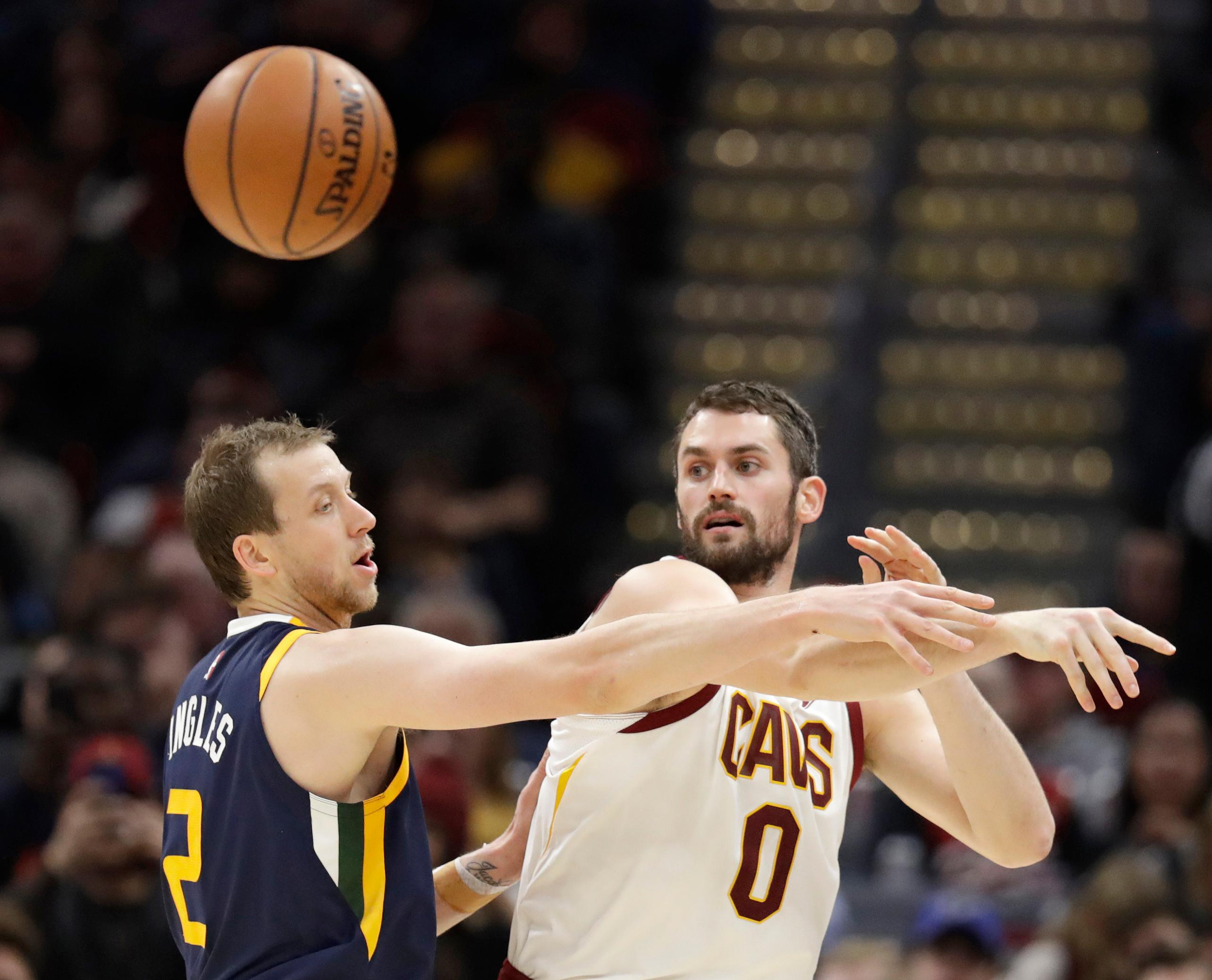 Cleveland Cavaliers' Kevin Love (0) passes against Utah Jazz's Joe Ingles (2), from Australia, in the first half of an NBA basketball game, Saturday, Dec. 16, 2017, in Cleveland. (AP Photo/Tony Dejak)