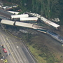 At least 6 dead, scores injured after Amtrak train plunges off bridge onto I-5