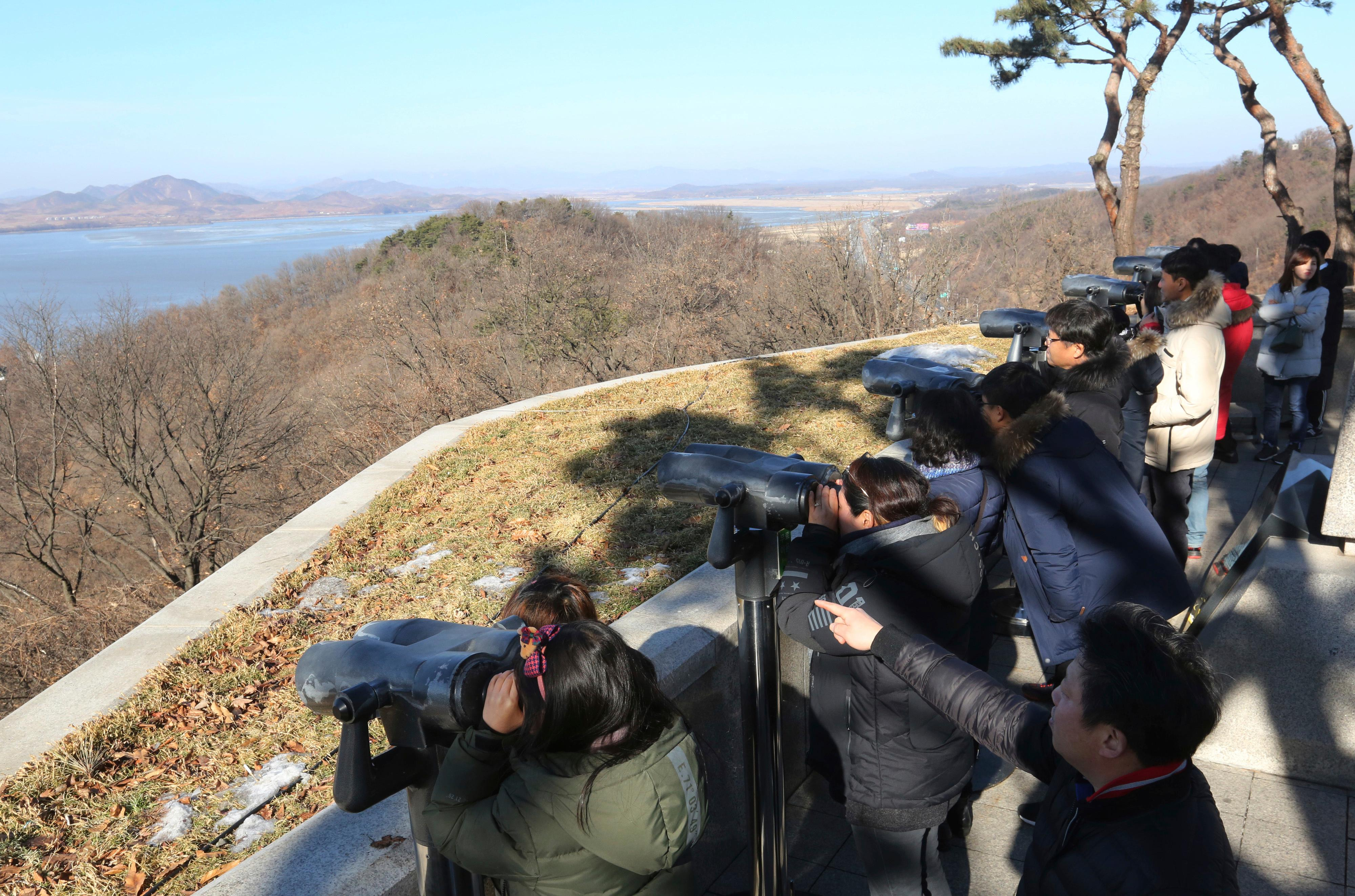 "Visitors watch the North Korean side at the unification observation post in Paju, South Korea, near the border with North Korea Monday, Dec. 25, 2017. North Korea on Sunday called the latest U.N. sanctions to target the country ""an act of war"" that violates its sovereignty, and said it is a ""pipe dream"" for the United States to think it will give up its nuclear weapons. (AP Photo/Ahn Young-joon)"