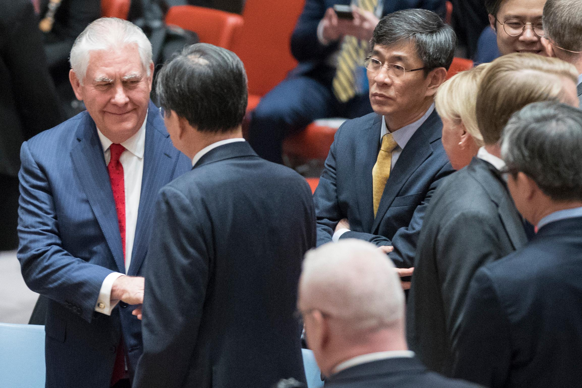 American Secretary of State Rex Tillerson, left, greets South Korean Vice Minister of Foreign Affairs Cho Hyun before the start of a high level Security Council meeting on the situation in North Korea, Friday, Dec. 15, 2017 at United Nations headquarters. (AP Photo/Mary Altaffer)