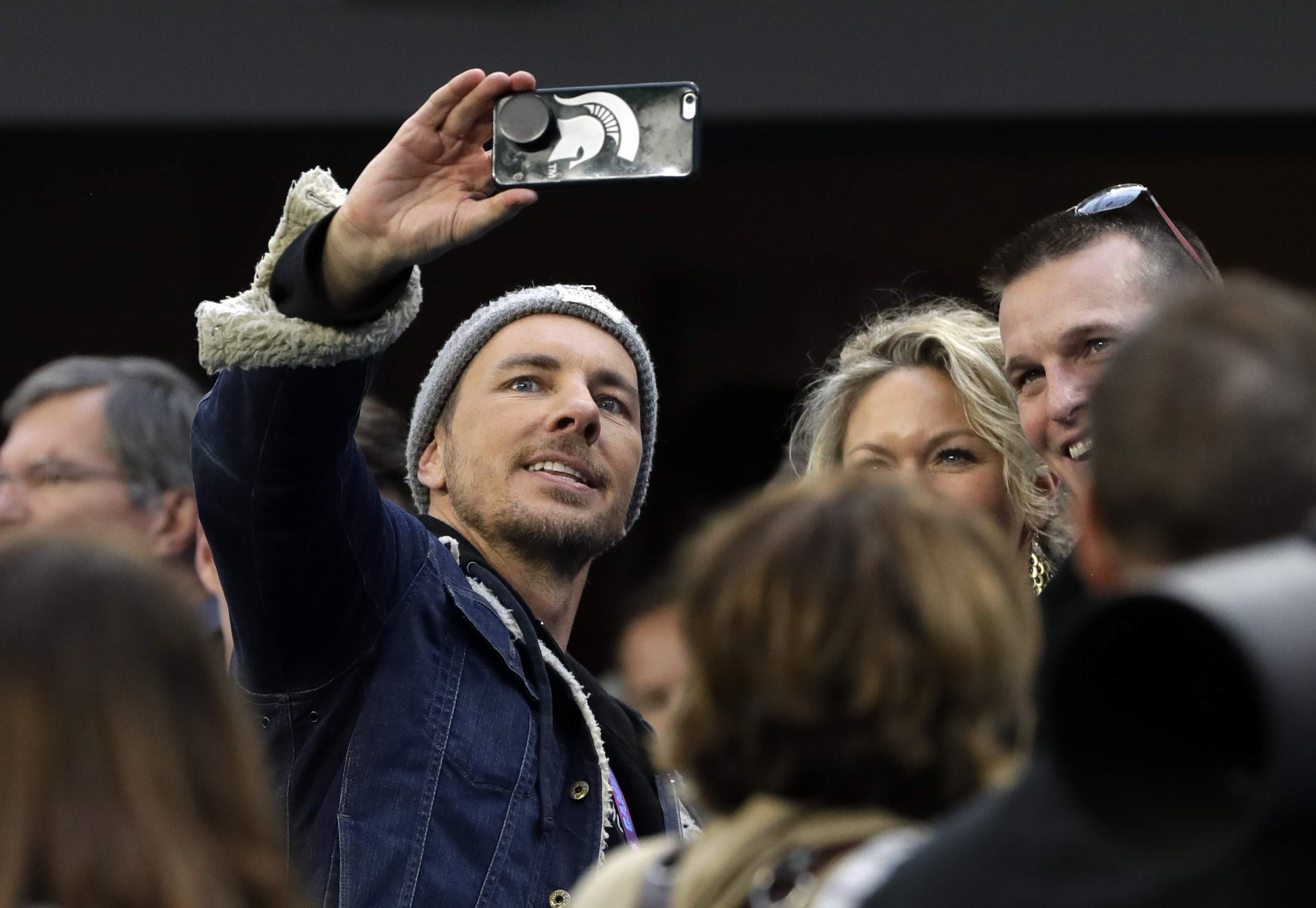 Actor Dax Shepard, left, takes selfie on the sideline, before the NFL Super Bowl 52 football game between the Philadelphia Eagles and the New England Patriots Sunday, Feb. 4, 2018, in Minneapolis. (AP Photo/Chris O'Meara)