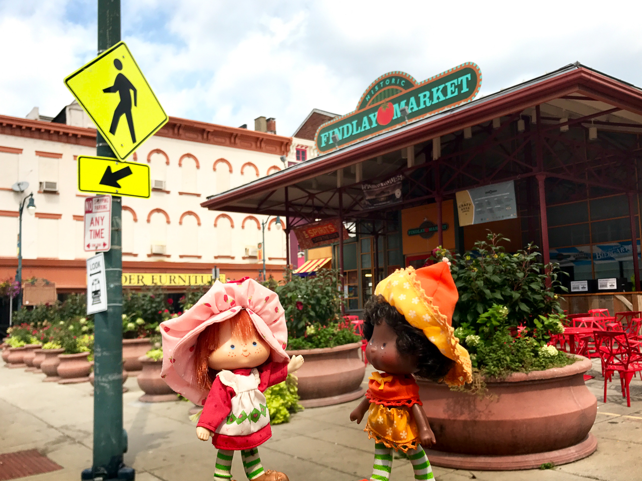 Strawberry Market / Kristian Geer uses forced perspective photography (not Photoshop) to inject surreal elements–that is, toys–into every day scenes to alter their significance. Pulling from an infinite well of imagination, his creativity paints the Queen City as a technicolor dreamscape for a cast of fictional characters interacting with our real world. / Image: Kristian Geer // Published: 8.29.18