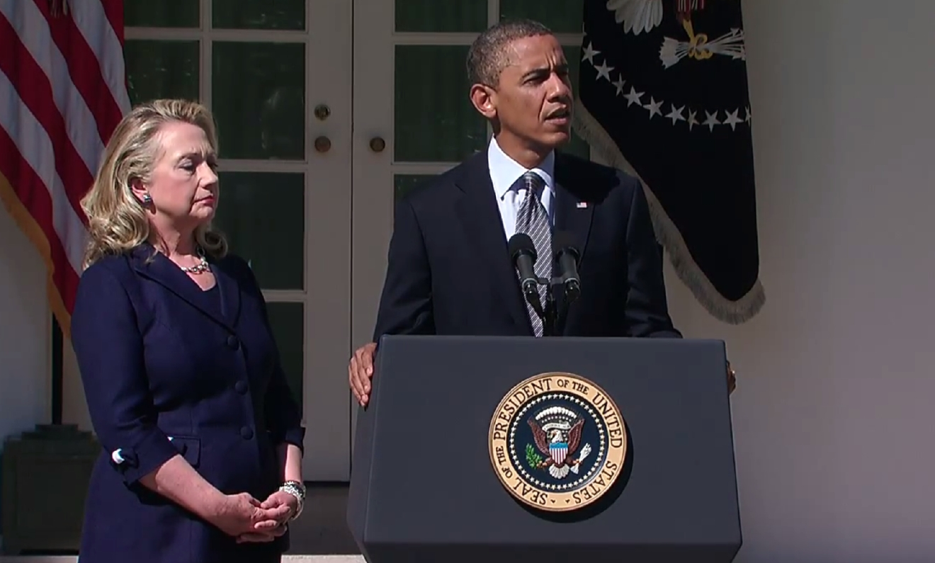 Hillary Clinton stands with Barack Obama in the White House Rose Garden on September 12, 2012 as he delivers a statement on the attacks in Benghazi. (White House/YouTube)