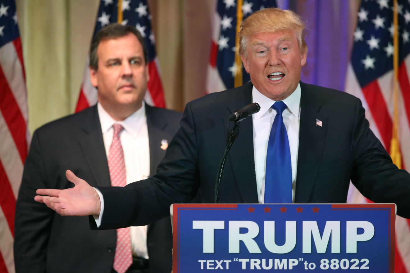 Republican presidential candidate Donald Trump speaks on Super Tuesday primary election night at the White and Gold Ballroom at The Mar-A-Lago Club in Palm Beach, Fla., Tuesday, March 1, 2016, as New Jersey Gov. Chris Christie listens. (AP Photo/Andrew Harnik)