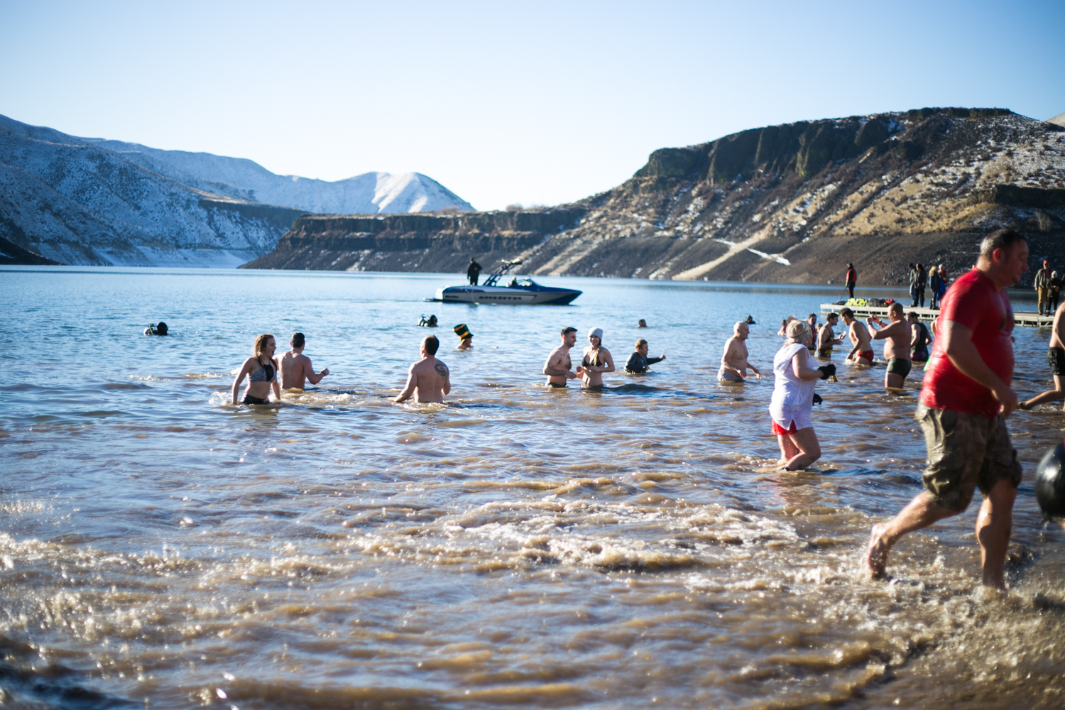 Brave individuals kick off the New Year by plunging into the icy waters of Lucky Peak at the Great Polar Bear Challenge. The event is a fundraiser where people of all ages dive into lake to raise funds for Idaho's wish children. (Kristen McPeek Photo)