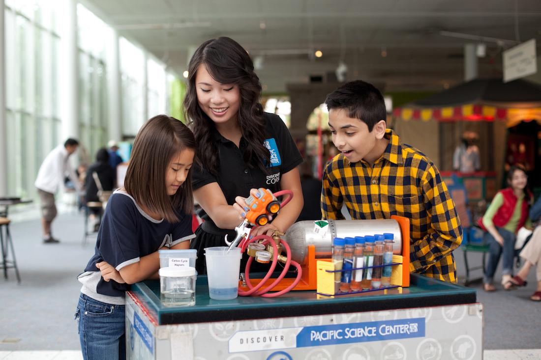 Children conduct an experiment at the Pacific Seattle Center. (Photo courtesy of Pacific Seattle Center)