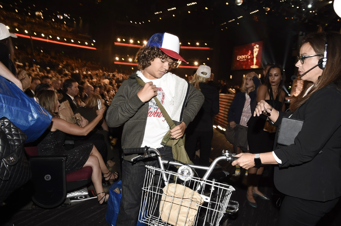 "Gaten Matarazzo of ""Stranger Things"" hands out sandwiches to the audience at the 68th Primetime Emmy Awards in Los Angeles on Sept. 18, 2016. (Photo by Dan Steinberg/Invision for the Television Academy/AP Images)"