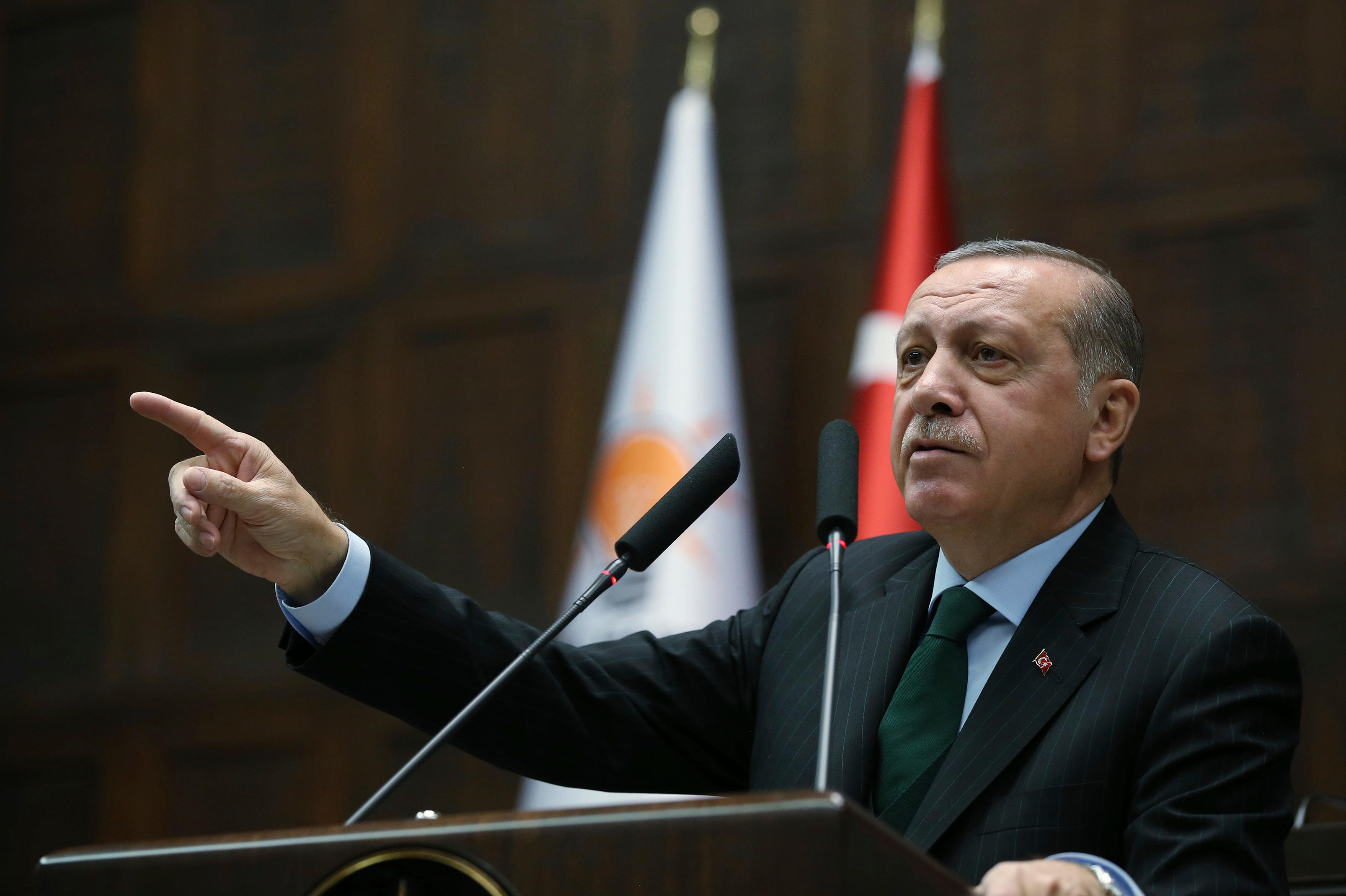 Turkey's President Recep Tayyip Erdogan gestures as he delivers a speech during a meeting of his ruling Justice and Development Party (AKP), in Ankara, Turkey, Tuesday, Dec. 5, 2017. Erdogan says U.S. recognition of Jerusalem as Israel's capital is a 'red line' for Muslims and also said such a step would lead Turkey to cut off all diplomatic ties with Israel. (Yasin Bulbul/Pool via AP)