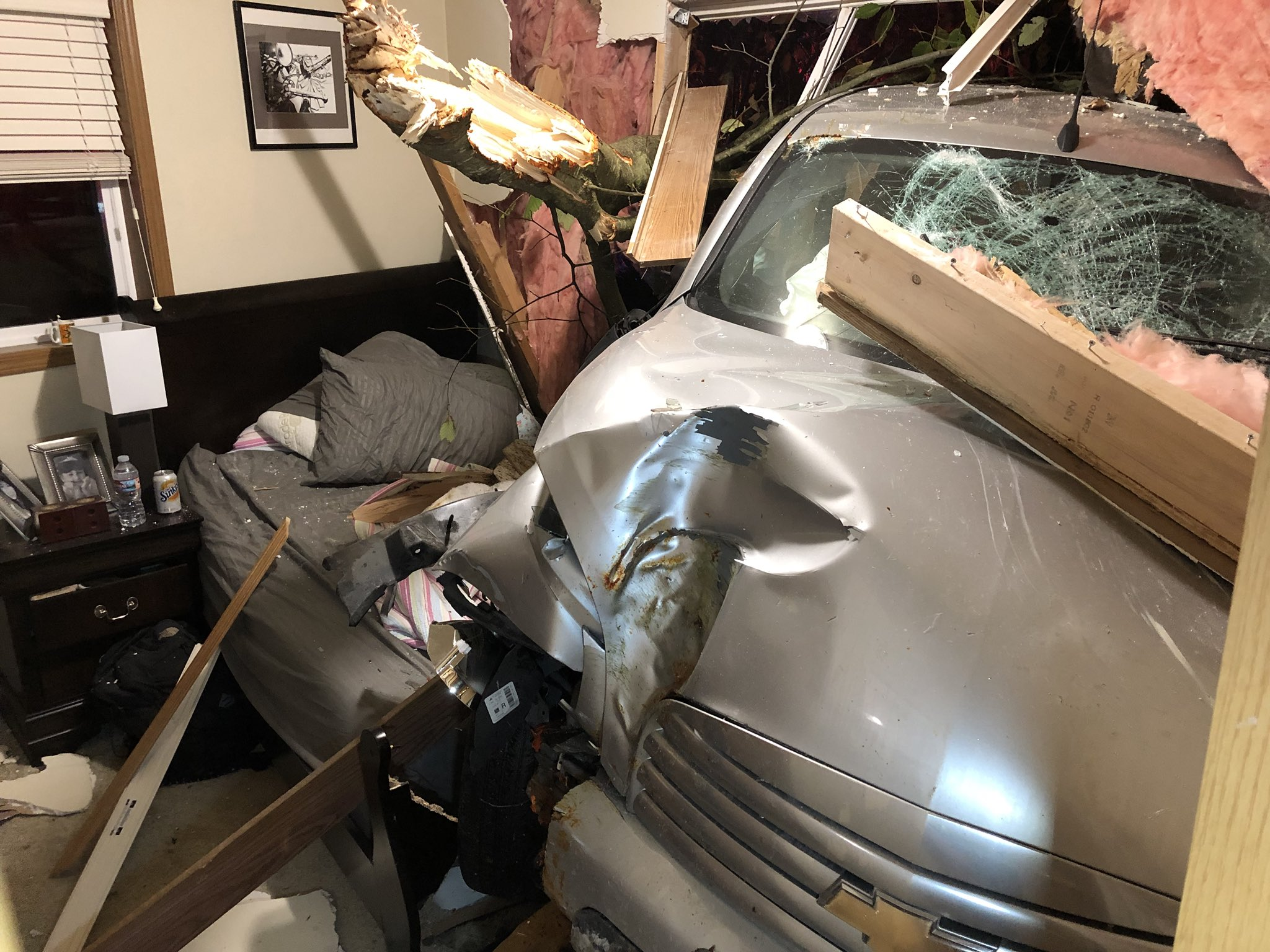 A car with two adults and a child crashed through a wall of a home in Federal Way overnight, injuring a woman in the bed on the other side.{&amp;nbsp;}(Photo credit: South King Fire and Rescue)<p></p>