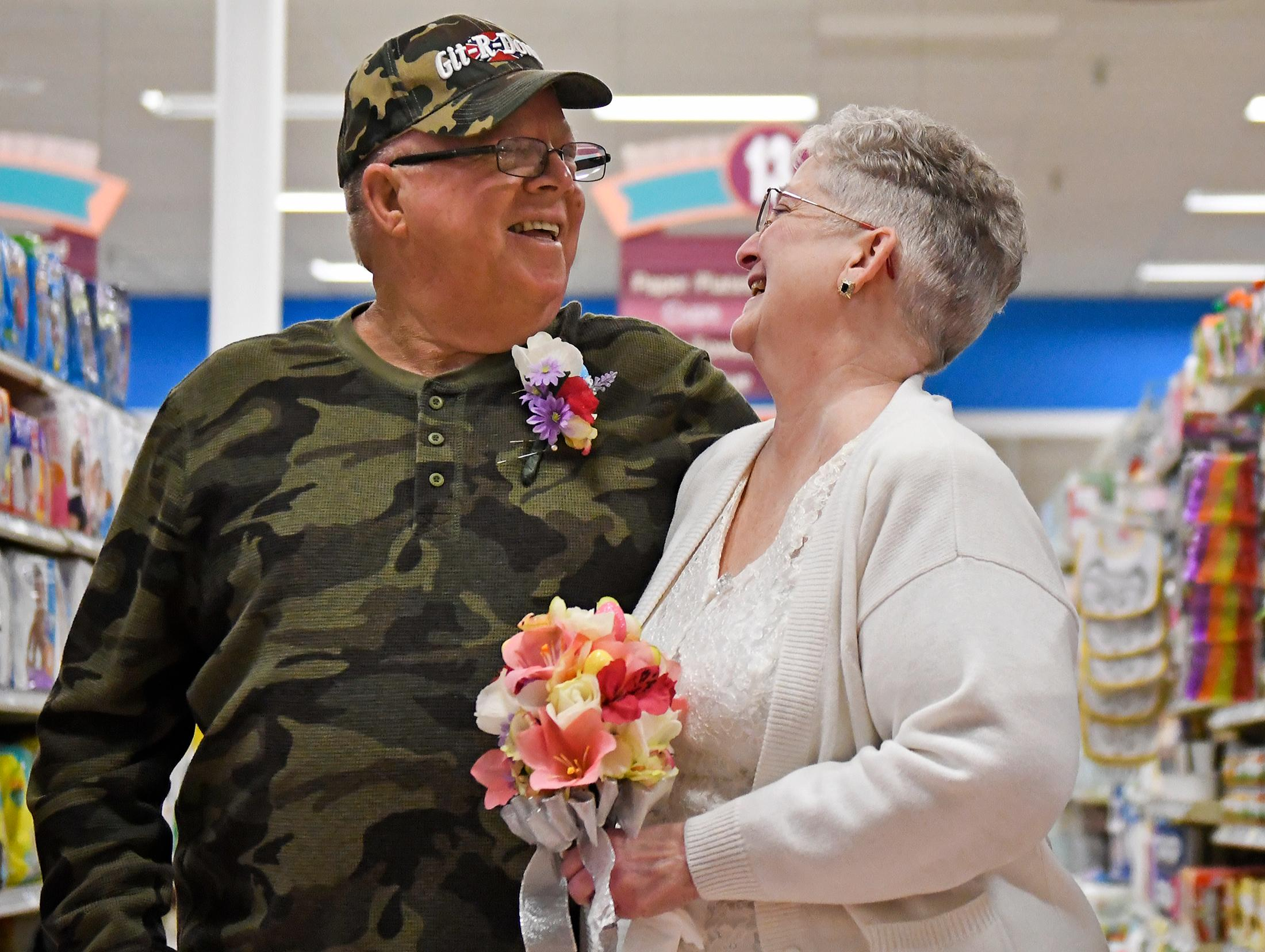 In this April 1, 2018 photo, Larry Spiering and Becky Smith smile where they held their wedding ceremony on Easter Sunday in aisle 13 of the Community Market in Lower Burrell, Pa. Smith said she was working at the supermarket when Spiering walked up and gave her a piece of paper with his name and phone number on it. She said it was only fitting that they married in the aisle where they met. (Jack Fordyce/Pittsburgh Tribune-Review via AP)
