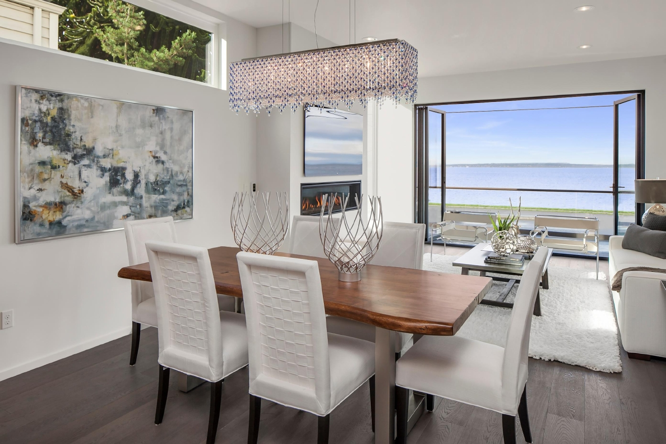 This gorgeous home, located on the waterfront of Alki, is where modern luxury meets beach living. With 5 beds and 4 baths, this 2,880 square foot home is a stone's throw away from the waterfront. This home is listed by The Deol Group for $1,999,000.  Find this home on The Deol Group's web page. MLS #1050914  http://www.thedeolgroup.com/homes/1766-Alki-Ave-SW/Seattle/WA/98116/67947414/ (Image courtesy of The Deol Group).