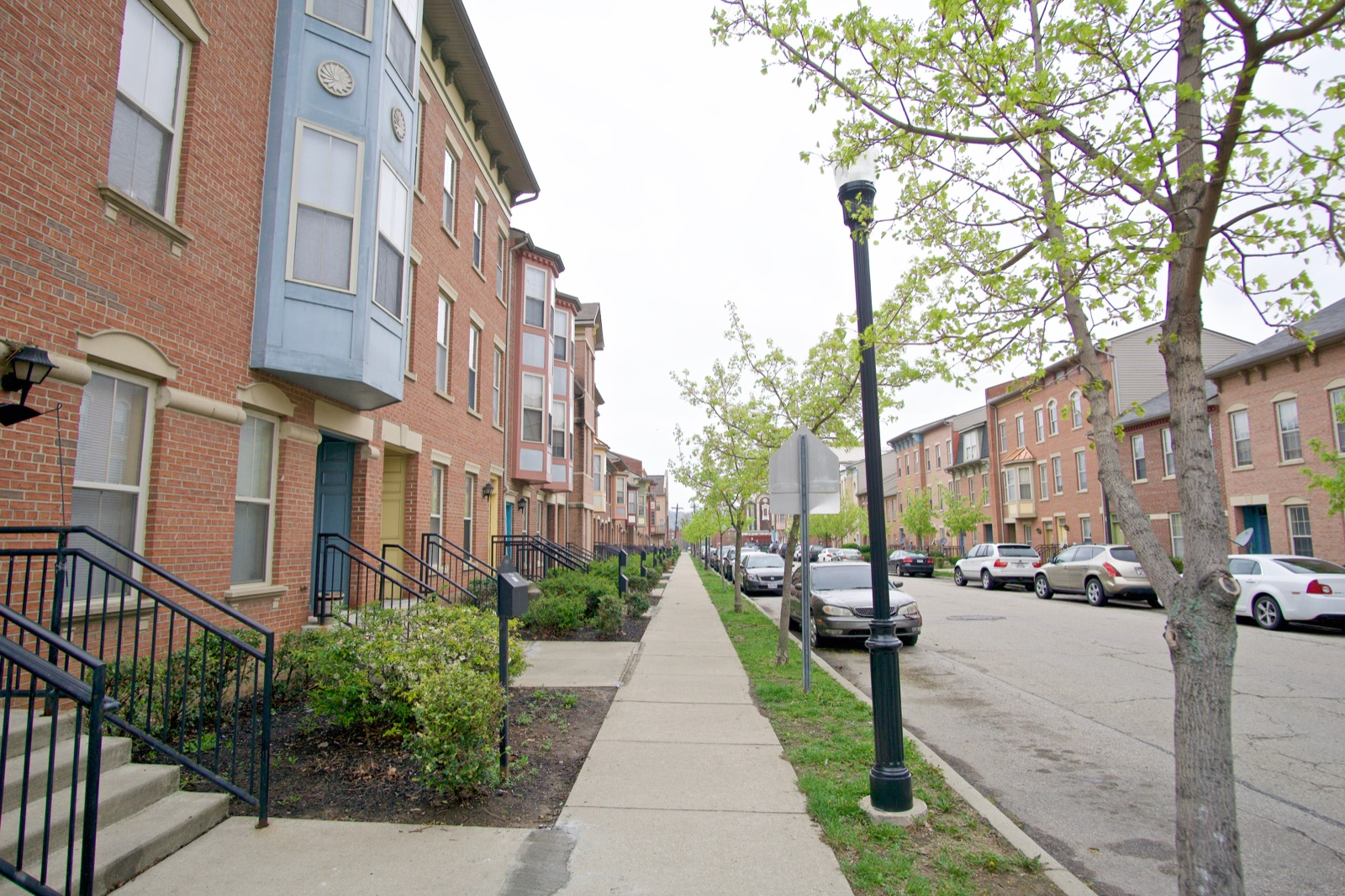 City West came into being in 1999, after HUD awarded the Cincinnati Metropolitan Housing Authority two HOPE VI grants to remake Lincoln Court and Laurel Homes (two enormous housing projects) into a mixed-income neighborhood. The result is a walkable, transit-accessible, and dense area with row houses and lush green space. FC Cincinnati's incoming stadium is planned for the site next to City West. / Image: Brian Planalp // Published: 4.26.18
