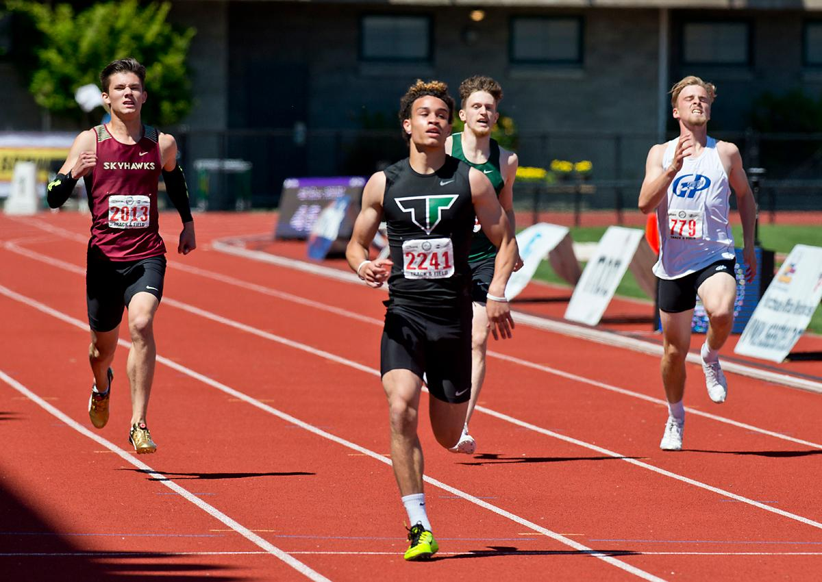 Braden Lenzy from Tigard wins the 6A Boys 400 meter dash with a time of 47.92 at the OSAA Championship at Hayward Field on Saturday. Photo by Dan Morrison, Oregon News Lab