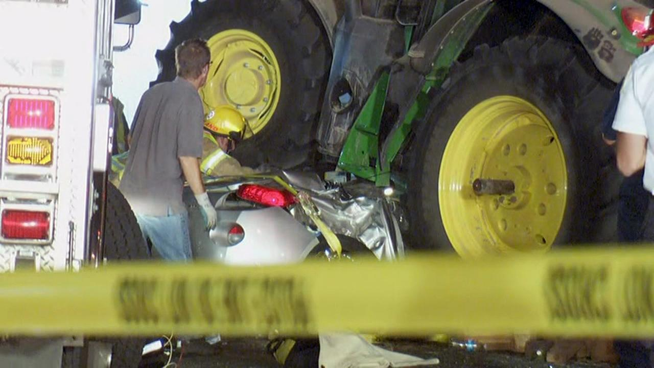 Rescuers work to free two people trapped in this car in Gaston, Oregon on Wednesday night after a tractor towing a combine crashed on top of them. (KATU Photo
