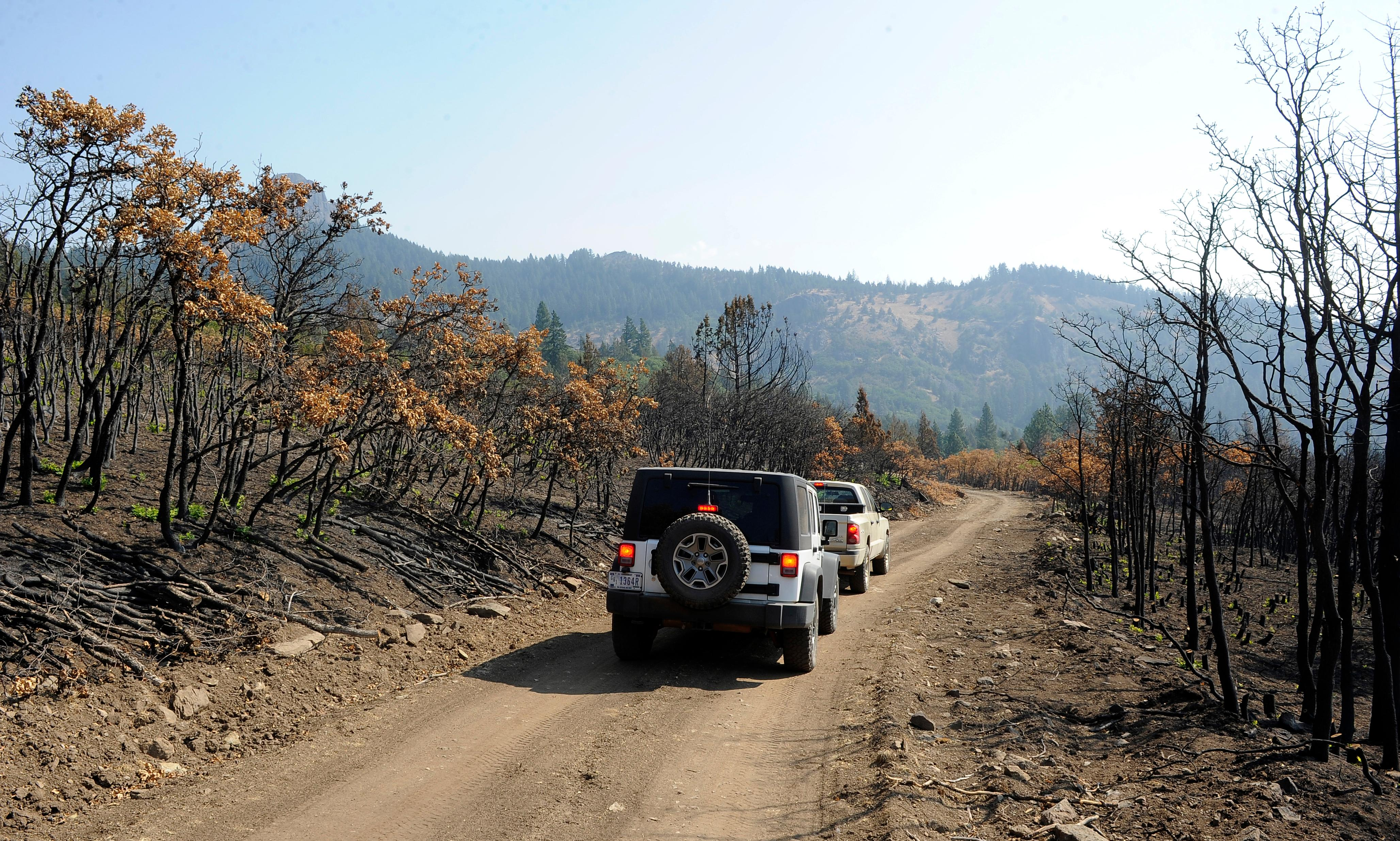 Andy Atkinson / Mail Tribune<br>Official forest vehicles make their way on a dozer-created road in the Soda Mountain Wilderness south of Pilot Rock where the Klamathon fire crossed the Oregon/California border.