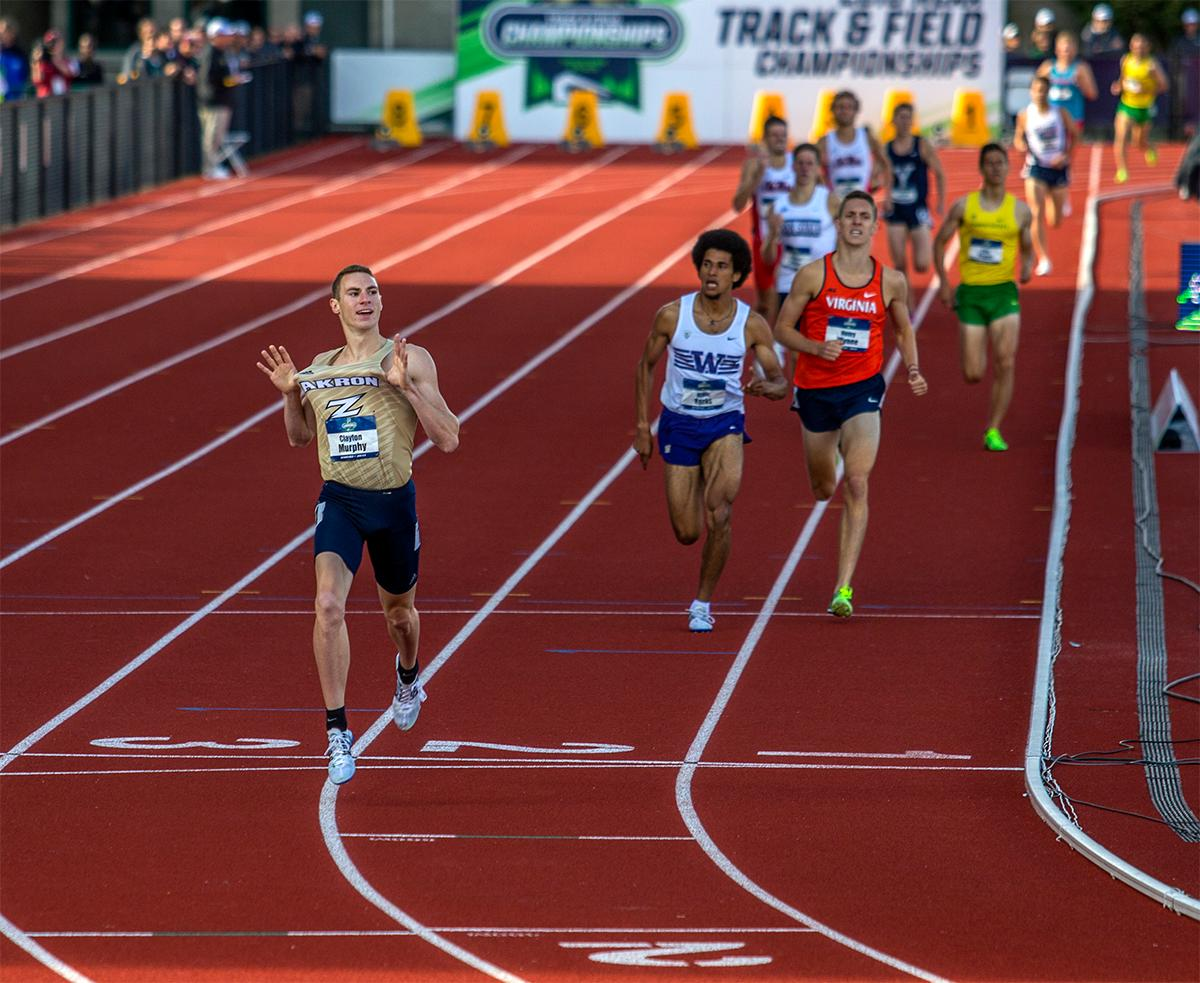Akron's Clayton Murphy celebrates as he crosses the line in the 1,500 meter in a time of 3:36.38.  Photo by August Frank, Oregon News Lab