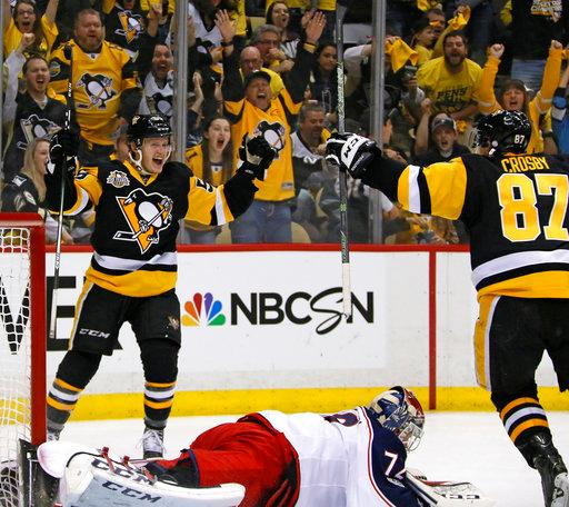 Pittsburgh Penguins' Jake Guentzel, left, celebrates his goal with Sidney Crosby (87) as Columbus Blue Jackets goalie Sergei Bobrovsky (72) lies in the goal crease during the second period in Game 2 of an NHL first-round hockey playoff series in Pittsburgh, Friday, April 14, 2017. (AP Photo/Gene J. Puskar)