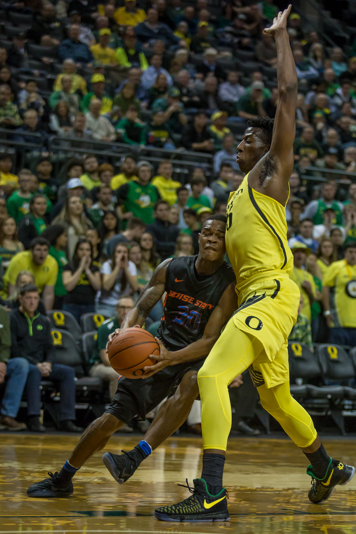 Boise State guard Paris Austin (#30) runs into Oregon forward Kavell Bigby-Williams (#35) on his way to the hoop. After trailing for most of the game, the Oregon Ducks defeated the Boise State Broncos 68-63. Photo by Dillon Vibes