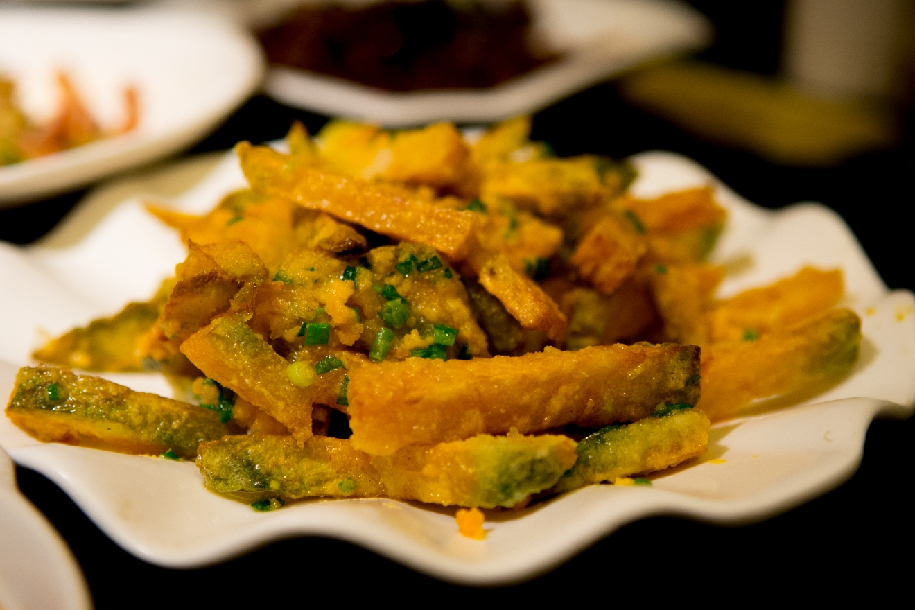Cured egg yolk on tempura squash in Shanghai (Image: Naomi Tomky / Seattle Refined)