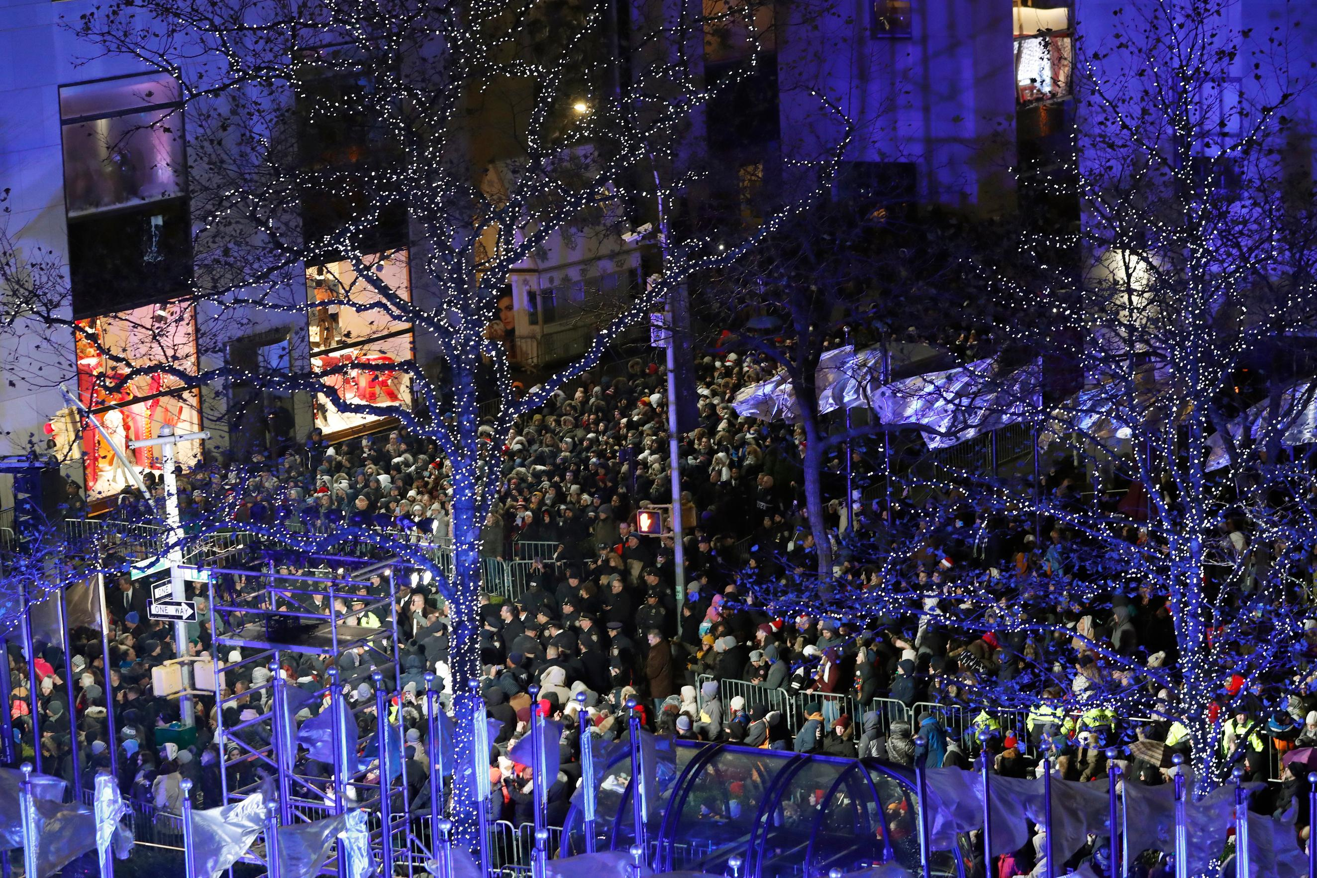 Crowds gather in Rockefeller Center to watch the 87th annual Rockefeller Center Christmas Tree lighting ceremony, Wednesday, Dec. 4, 2019, in New York. (AP Photo/Kathy Willens)