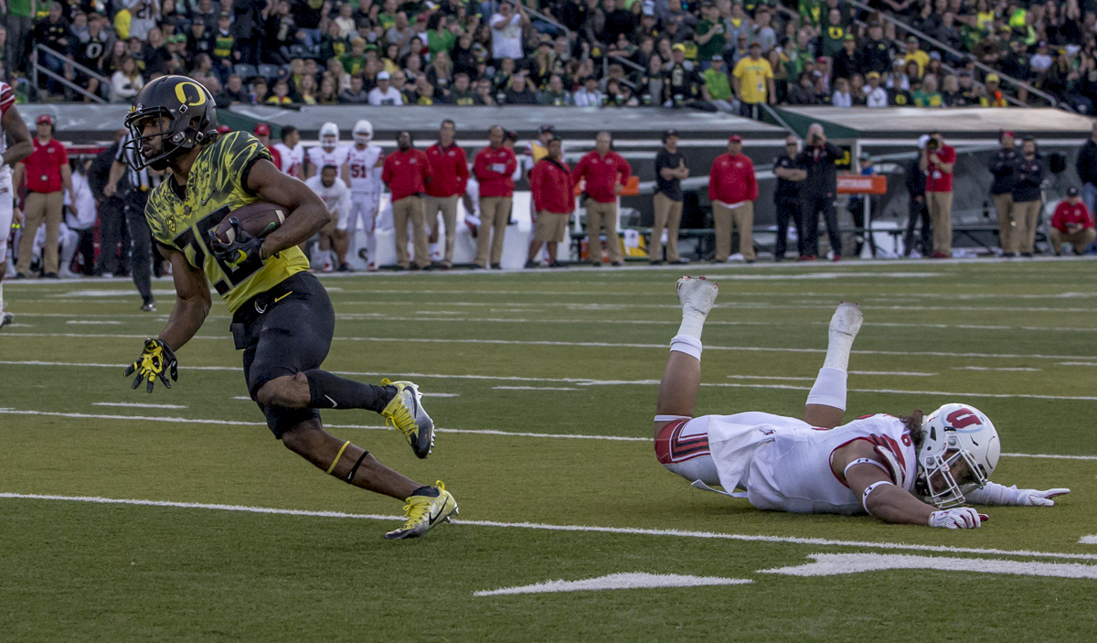 Oregon running back Tony Brooks-James (#20) runs for a touchdown. The Oregon Ducks defeated the Utah Utes 41 to 20 during Oregon's homecoming game at Autzen Stadium on Saturday, October 28, 2017. Photo by Ben Lonergan, Oregon News Lab