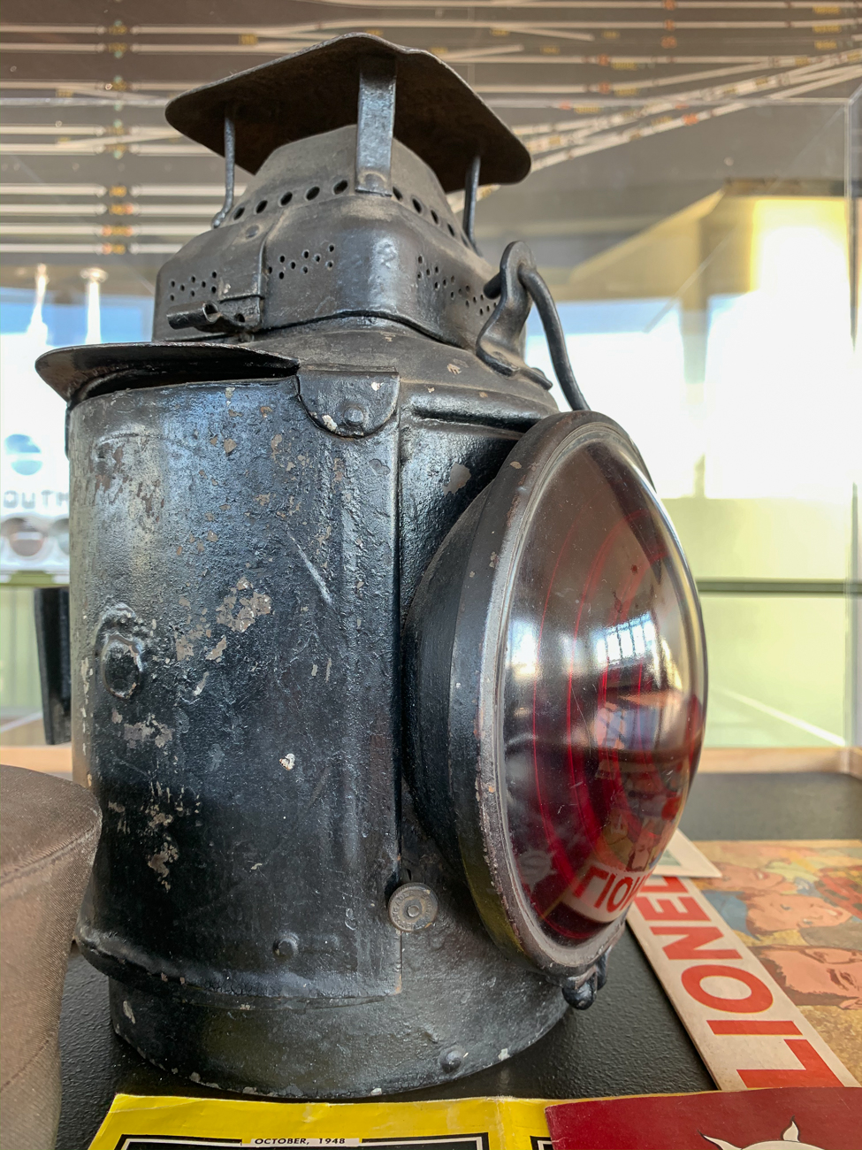 Two displays with various railroad-related paraphernalia can be seen inside the tower today. Old pamphlets, garments, tools, and other odds and ends occupy glass cases. / Image: Phil Armstrong, Cincinnati Refined // Published: 1.17.20