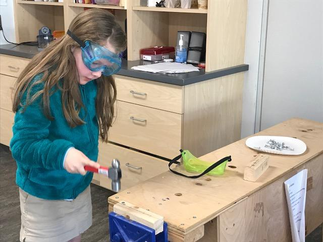 Teachers at Carolina Day School take a different approach to STEM by having students learn from the origins of modern technology.  (Photo credit: WLOS Staff)