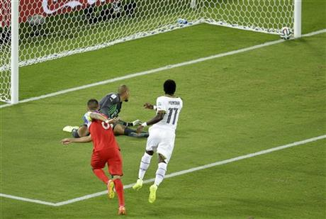 United States' Clint Dempsey, left, scores the opening goal past Ghana's goalkeeper Adam Kwarasey, center, during the group G World Cup soccer match between Ghana and the United States at the Arena das Dunas in Brazil Monday.