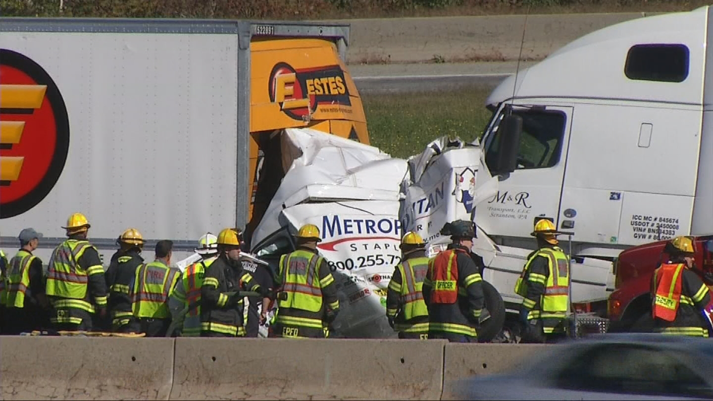 A van was crushed between two tractor-trailer trucks on Interstate 195 west in East Providence, Tuesday, Oct. 3, 2017. (WJAR)