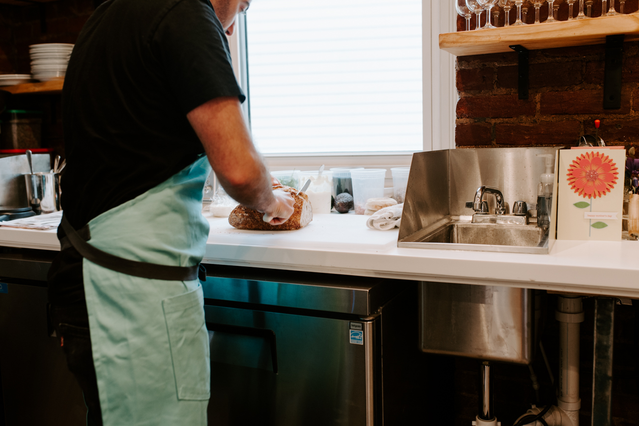 Tony Ferarri behind the counter, whipping up the delicious food options / Image: Brianna Long // Published: 6.10.19