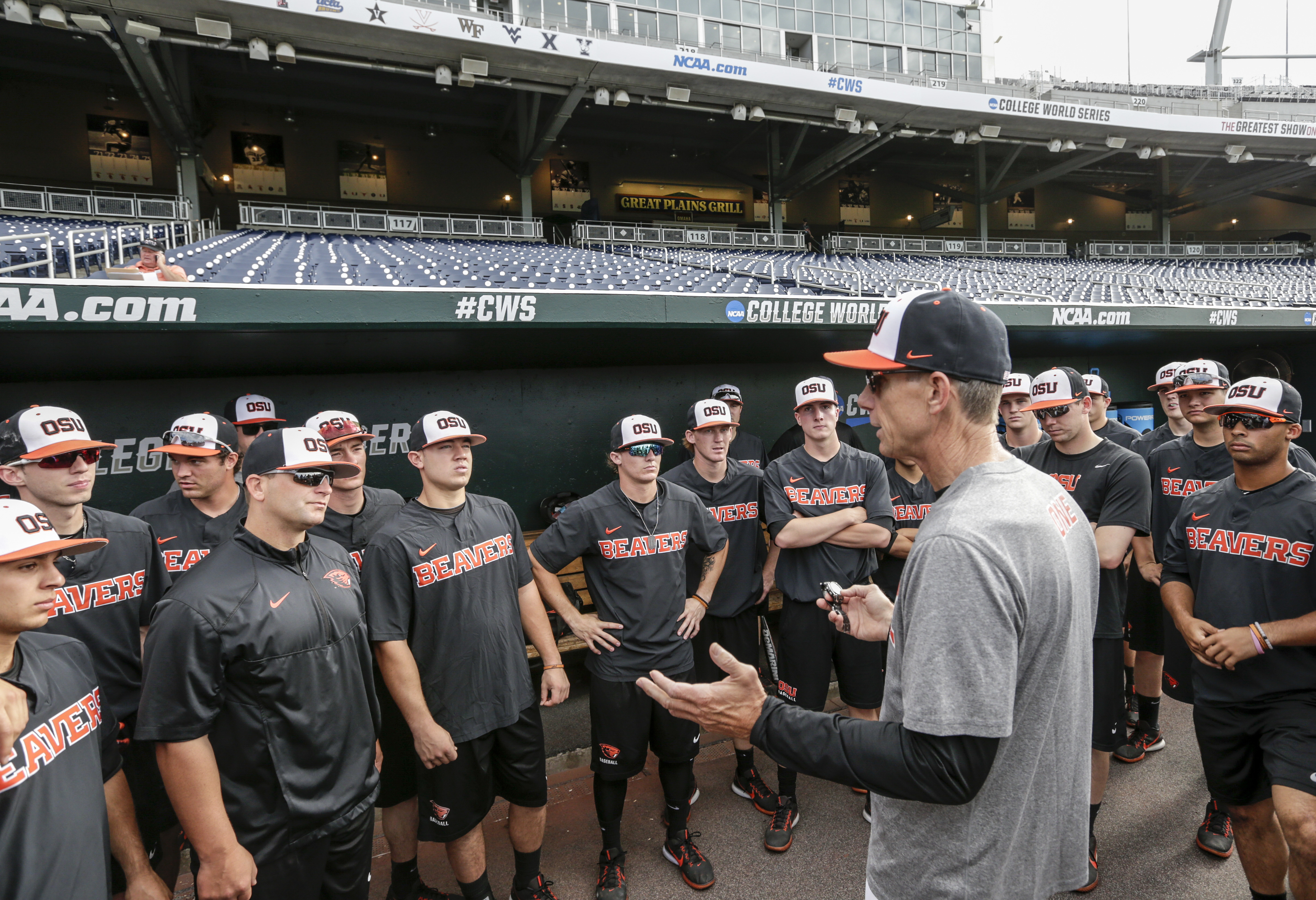 Oregon State coach Pat Casey addresses his players in the dugout before team practice in Omaha, Neb., Friday, June 16, 2017. Oregon State is on the cusp of joining the company of the greatest college baseball teams of all time. At 54-4, the Beavers enter the College World Series with the fewest losses of any team since 1982. (AP Photo/Nati Harnik)