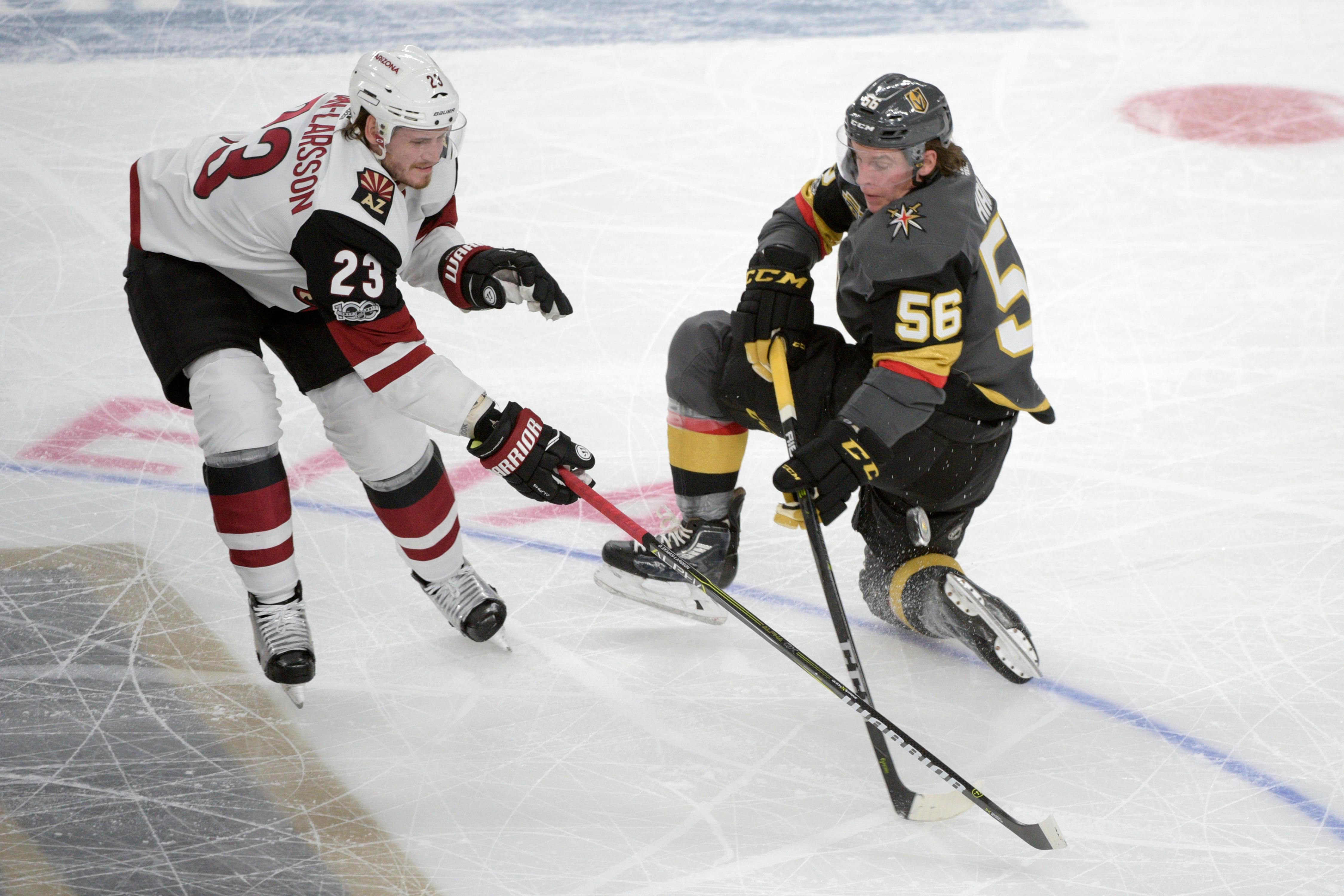 Vegas Golden Knights left wing Erik Haula (56) loses control of the puck under pressure from Arizona Coyotes defenseman Oliver Ekman-Larsson (23) during the Knights home opener Tuesday, Oct. 10, 2017, at the T-Mobile Arena. The Knights won 5-2 to extend their winning streak to 3-0. CREDIT: Sam Morris/Las Vegas News Bureau